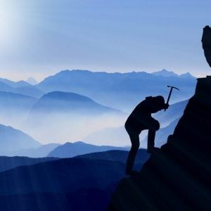 mountain climber silhouette with blue mountains