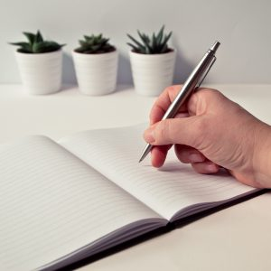 notebook and pen personal strategic plan